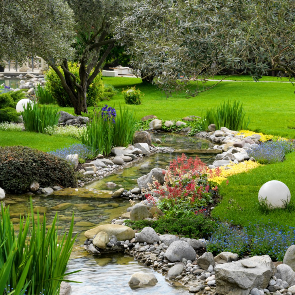 Part of this large Japanese garden contains a pond, above. Using rocks and native plants and pruning for special effects can help Maine gardeners create their own take on a Japanese garden.
