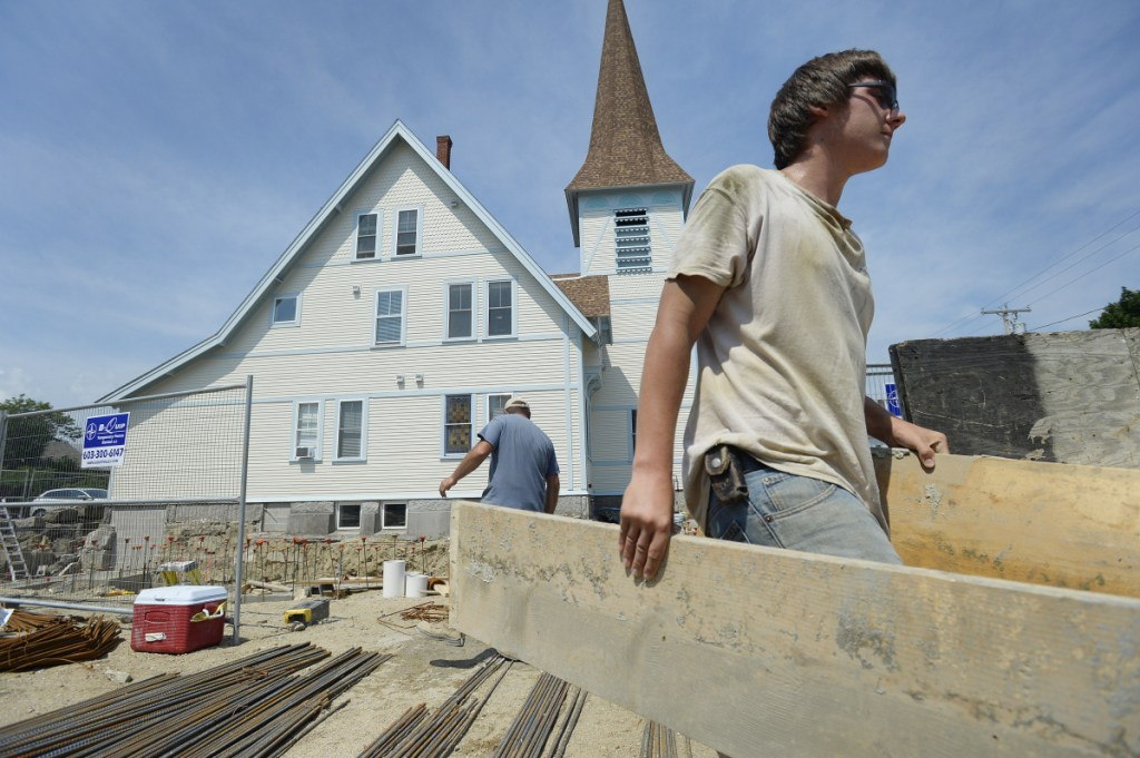 Brandon Norton works at the site of a future Cutts Avenue apartment complex in Saco, which had a 26 percent surge in permits over five years. Saco saw $38 million in new construction value in 2017.