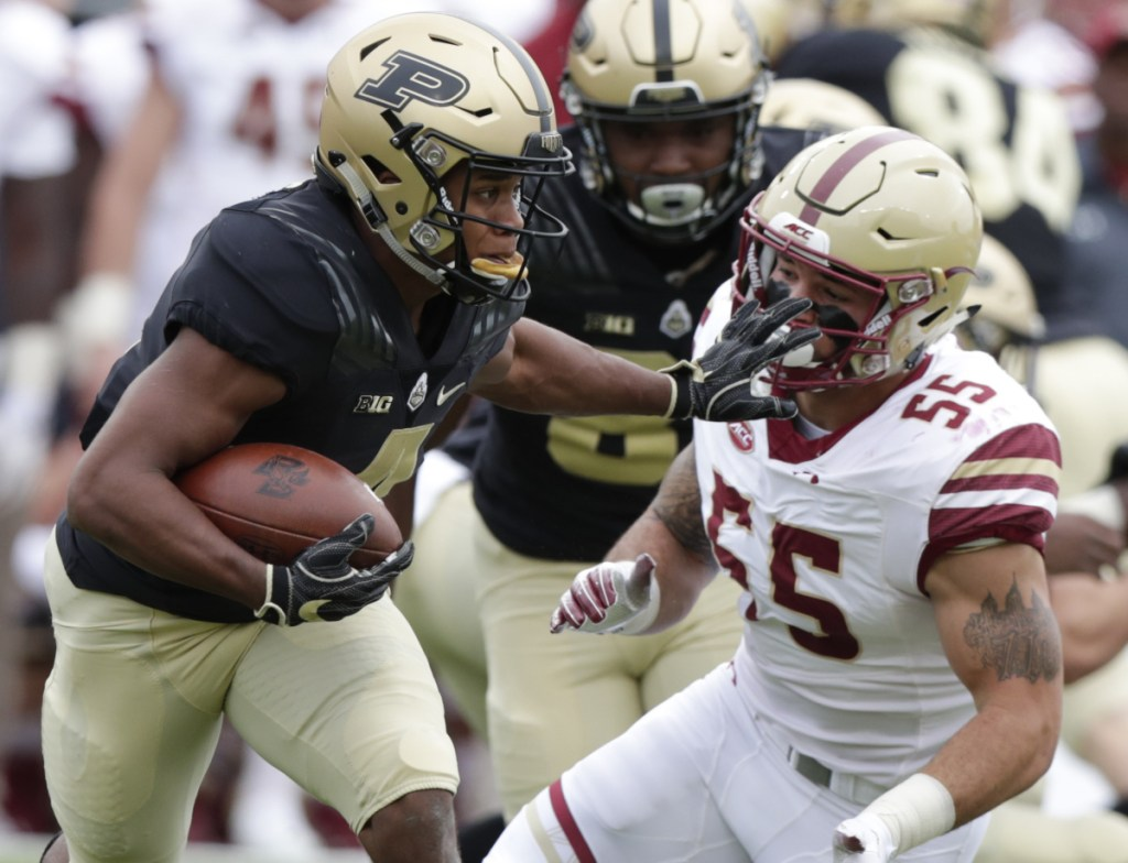 Rondale Moore of Purdue stiff-arms Boston College linebacker Isaiah McDuffie after making a catch Saturday during the first half of Purdue's 30-13 victory.
