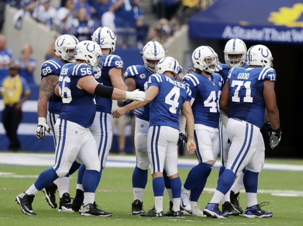 Indianapolis Colts kicker Adam Vinatieri (4) celebrates with teammates after kicking a 42-yard filed goal during the first half  Sunday in Indianapolis. Vinatieri passed Morten Andersen for the most career field goals made in NFL history with the field goal.