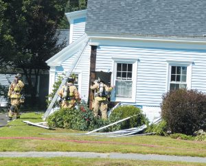 A HOME AT 304 MAINE ST. in Brunswick was damaged by fire on Monday morning. DARCIE MOORE/ THE TIMES RECORD