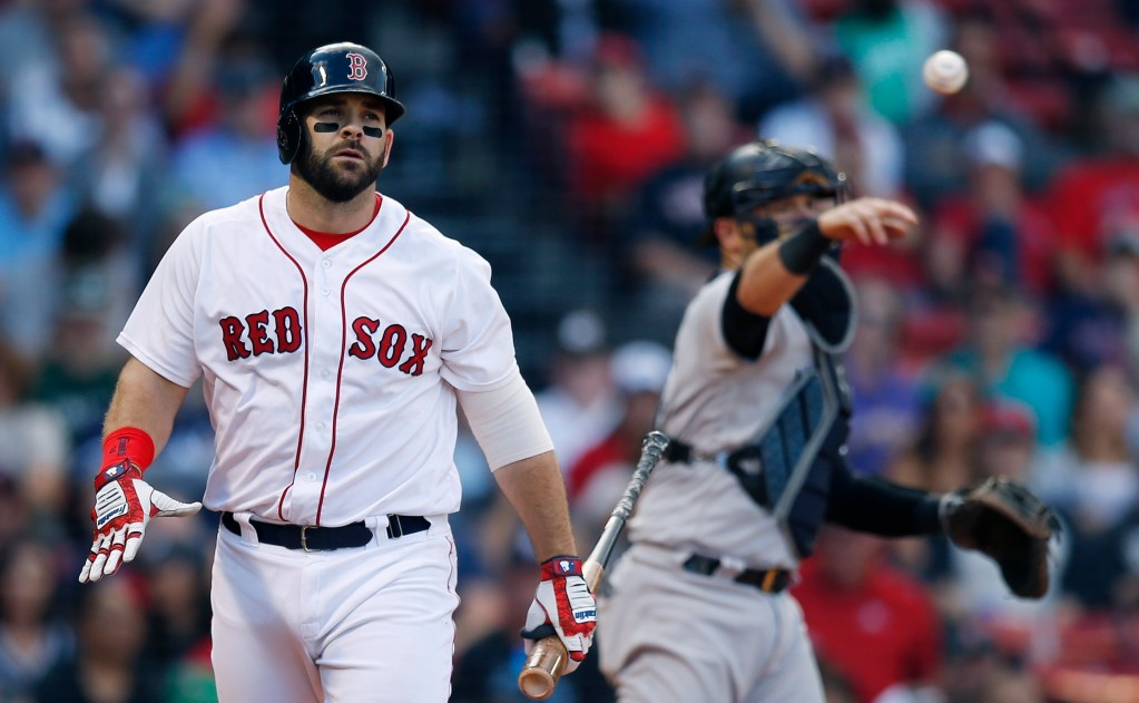 Boston Red Sox's Mitch Moreland walks back to the dugout after striking out in the ninth inning of a the Red Sox' 8-5 loss to the Yankees on Saturday in Boston.