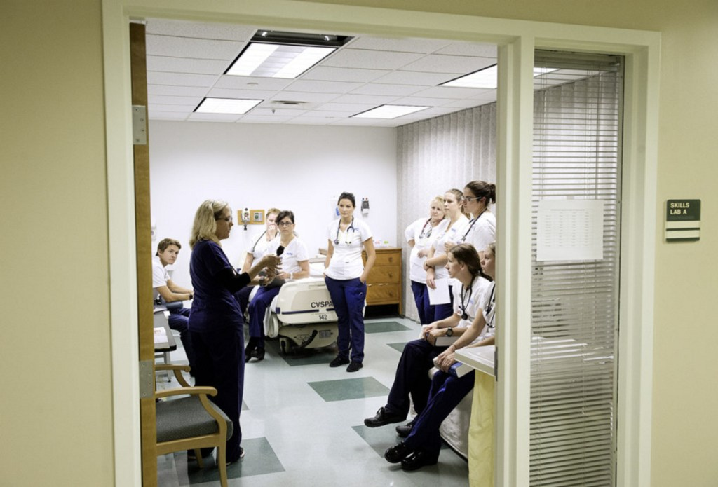 Registered Nurse Heidi Meek teaches how to make an initial visual evaluation of a patient to a freshman class of nursing students at the Maine College of Health Professions in Lewiston.