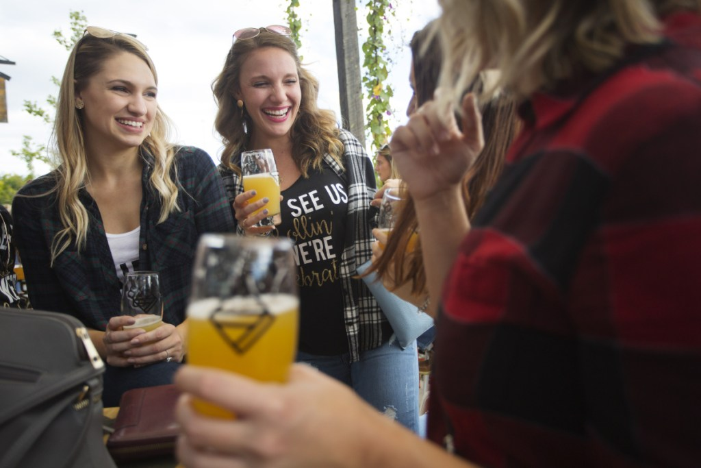 Haeley Stewart, left, of Derry, N.H., celebrates her bachelorette party with Brianna Ledoux of Merrimack, N.H., center, and other friends at the Bissell Brothers taproom at Thompson's Point on Saturday.