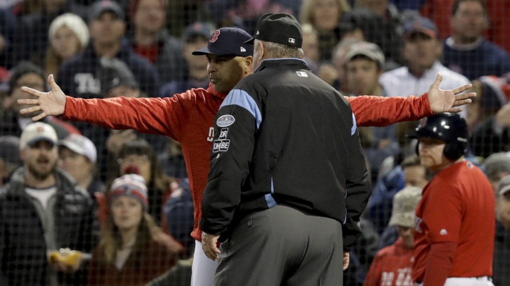 Boston Manager Alex Cora argues a strike three call with umpire Joe West during the fifth inning in Game 1 of a baseball American League Championship Series against the Houston on Saturday in Boston. Cora was thrown out of the game nd Houston went on to win Game 1.