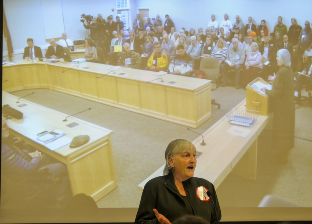 """Sheryl Harth of Jackman testifies against the CMP corridor proposal on Wednesday at the Maine Public Utilities Commission office in Hallowell. She said, """"Stay away from our wilderness."""""""