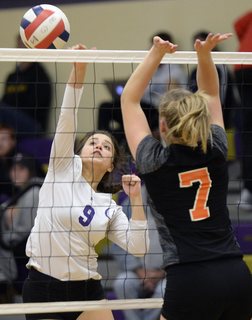 Kristina Matkevitch of Cheverus hits the ball past Sabrina Cooper of Brunswick during Cheverus' three-game sweep Thursday night to reach the Class A volleyball quarterfinals.