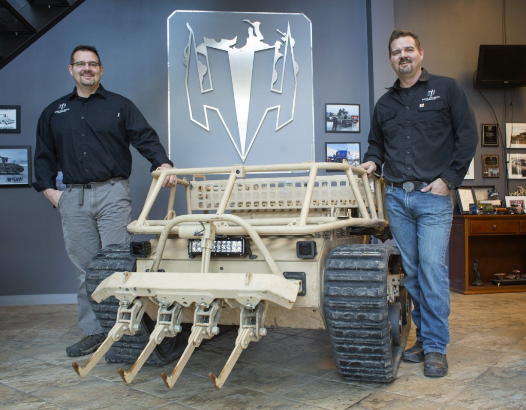 Seen in 2017, Howe and Howe Technologies President Michael Howe, left, and his twin, Geoff, the Waterboro company's CEO, will retain their roles after the planned sale to Textron this year.