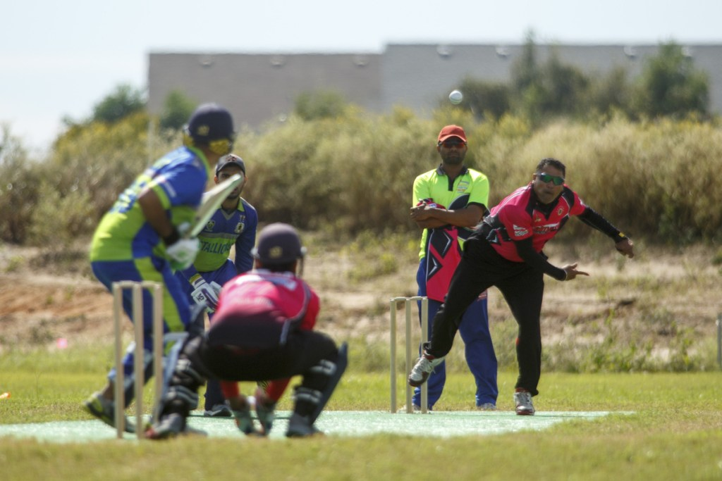 Bowler and batsman square off during a championship game on Oct. 21 at the nascent Prairie View Cricket Complex outside Houston.