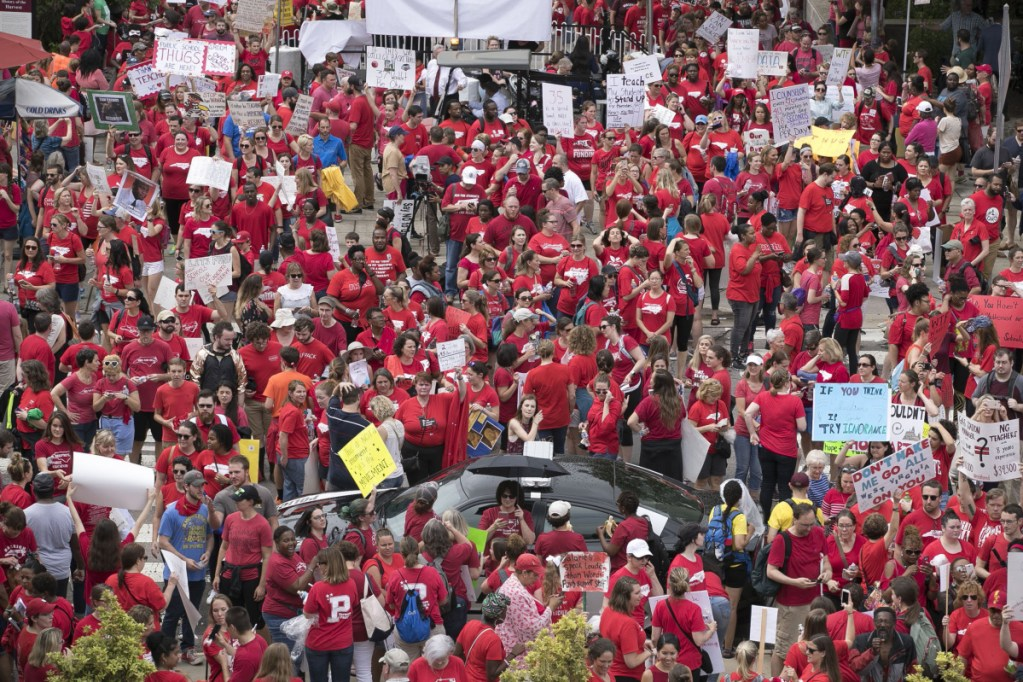 Thousands of North Carolina teachers descend upon the Legislature to lobby for better pay and education funding on May 16 in Raleigh, N.C.