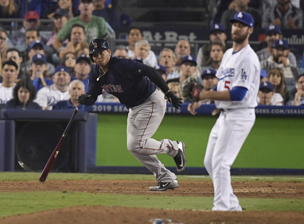 Rafael Devers laces a run-scoring single off reliever Dylan Floro of the Los Angeles Dodgers, driving in the tiebreaking run in the ninth inning Saturday and sparking the Boston Red Sox to a 9-6 victory and a 3-1 lead in the World Series.