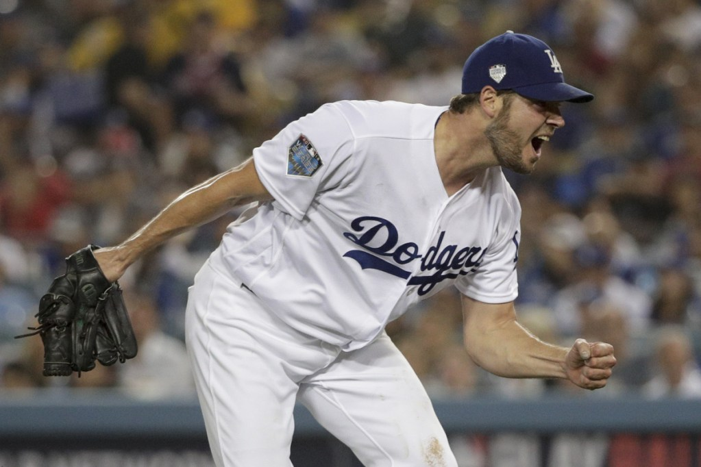 Dodgers starting pitcher Rich Hill celebrates after the last out in the top of the sixth inning against the Boston Red Sox in Game 4 of the World Series on Saturday in Los Angeles. He was pulled in the seventh inning despite allowing just one hit. (AP Photo/Jae C. Hong)