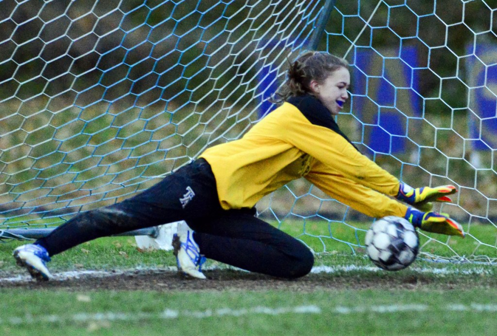 Traip Academy keeper Olivia O'Leary makes a save during penalty kicks in Wednesday's Class C South girls' soccer final. Maranacook outscored Traip 4-3 in penalty kicks to win 1-0.