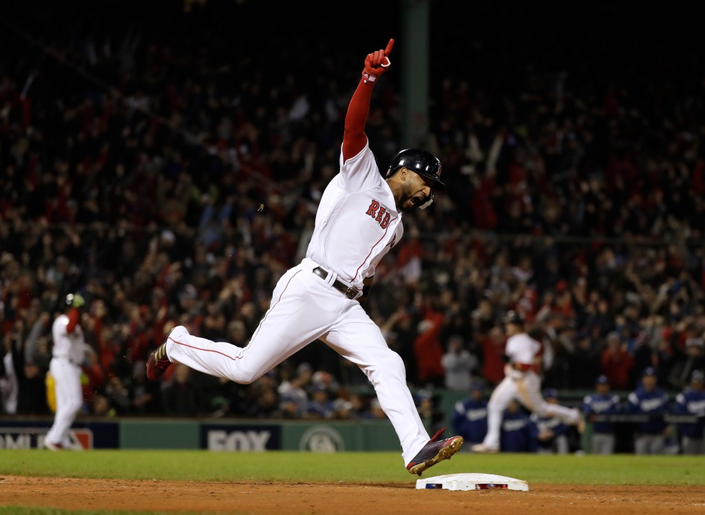 Boston's Eduardo Nunez celebrates his pinch-hit, three-run home run that blew open Game 1 of the World Series in the eighth inning.