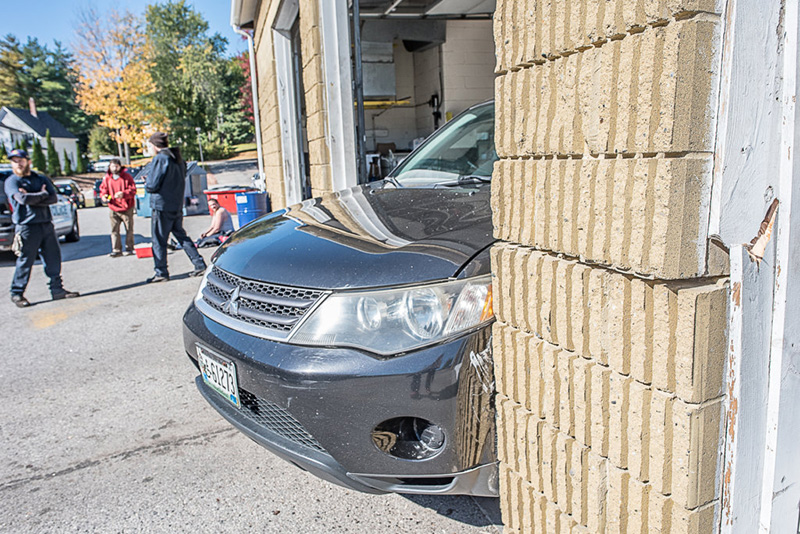 SUV smashes into Auburn oil change building, clips worker