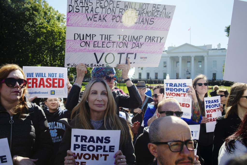 Demonstrators hold signs in support of trans equality outside the White House on Oct. 22 after President Trump threatened to roll back protections for transgender people.