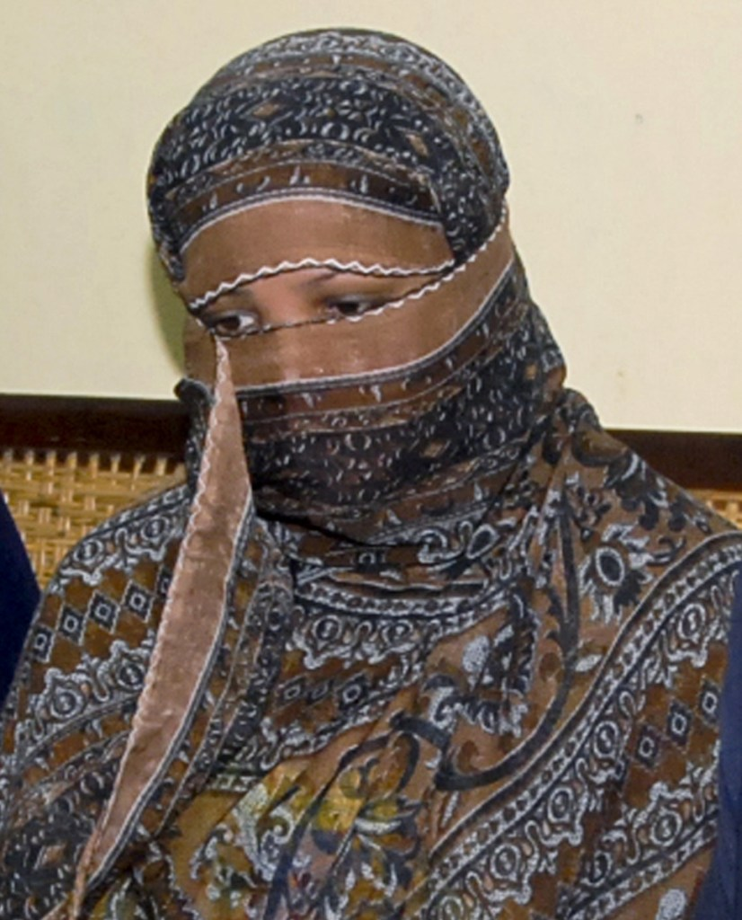 Asia Bibi, right, a Pakistani Christian woman, was sentenced to death in 2010 on blasphemy charges, but was spared by a Supreme Court ruling. The case has inflamed radical Islamists, above, who are calling for her death.