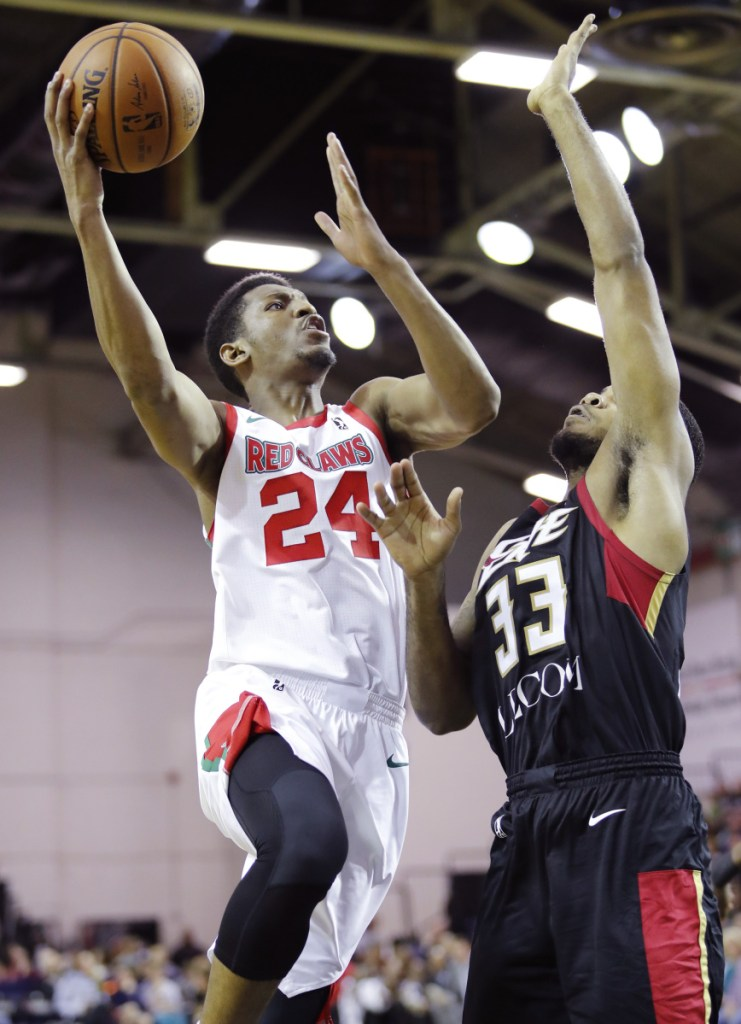 PORTLAND, ME - NOVEMBER 5: Red Claws' Andrew White, left, goes up for a shot while being guarded by Erie Bayhawks' Jeremy Hollowell, right, during the second period of their game Sunday, Nov. 5, 2017 in Portland, Maine. (Staff Photo by Joel Page/Staff Photographer)
