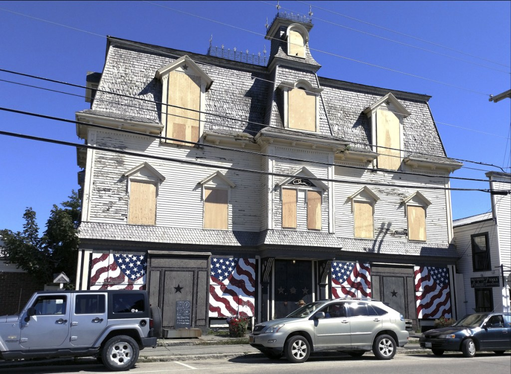 The windows of Robert Indiana's Star of Hope home on Main Street in Vinalhaven are boarded up. After roof repairs to stop leaks, the building will be winterized and closed until spring. It will ultimately undergo complete restoration and conversion to a museum in accordance with Indiana's will.