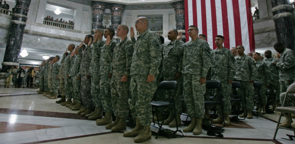 U.S. soldiers take the oath of citizenship in Baghdad in 2008. Military service has long offered immigrants a path to citizenship.