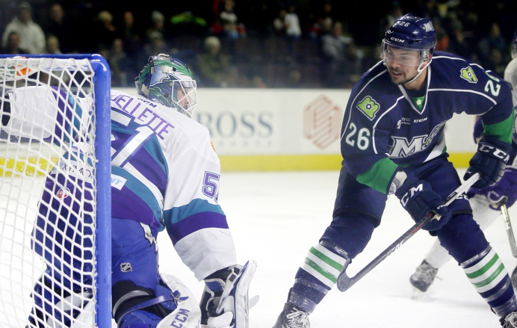 Shawn St. Amant flips the puck past Orlando Solar Bears goalie Martin Ouellette for one of his three goals Wednesday night, leading the Maine Mariners to a 6-3 win at Cross Insurance Arena.