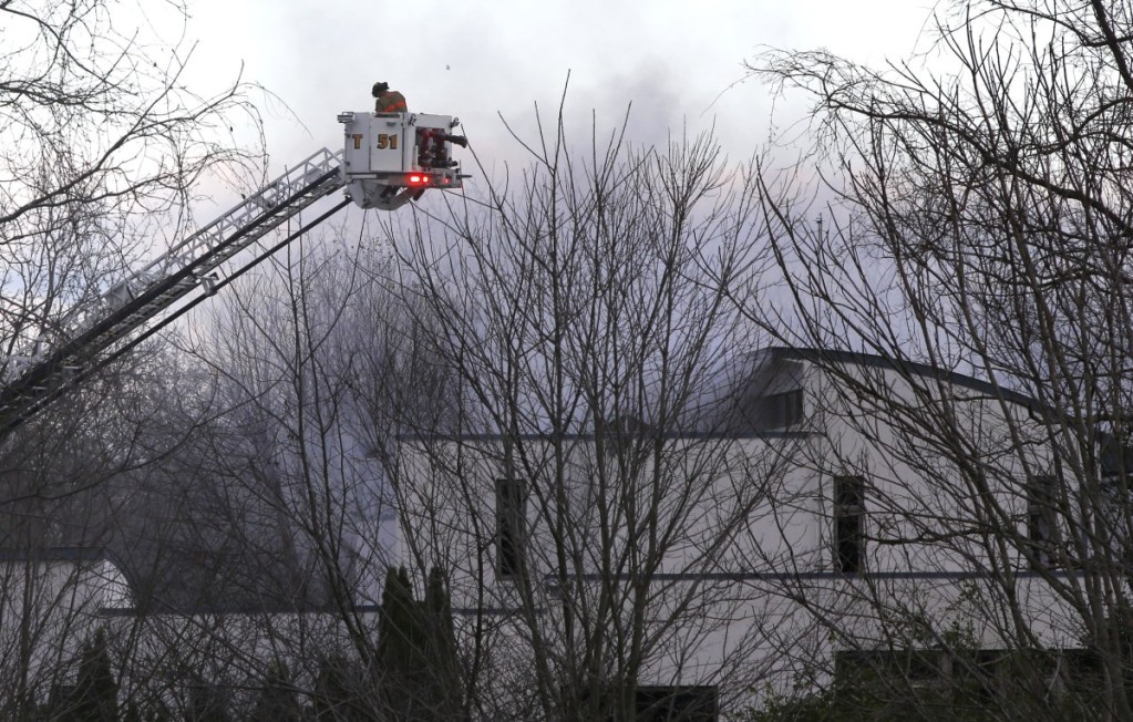 Firefighters work to extinguish a fatal fire in Colts Neck, New Jersey, on Tuesday. One of the owners is a technology CEO. A home owned by a relative who is vice president of the same company also burned Tuesday.