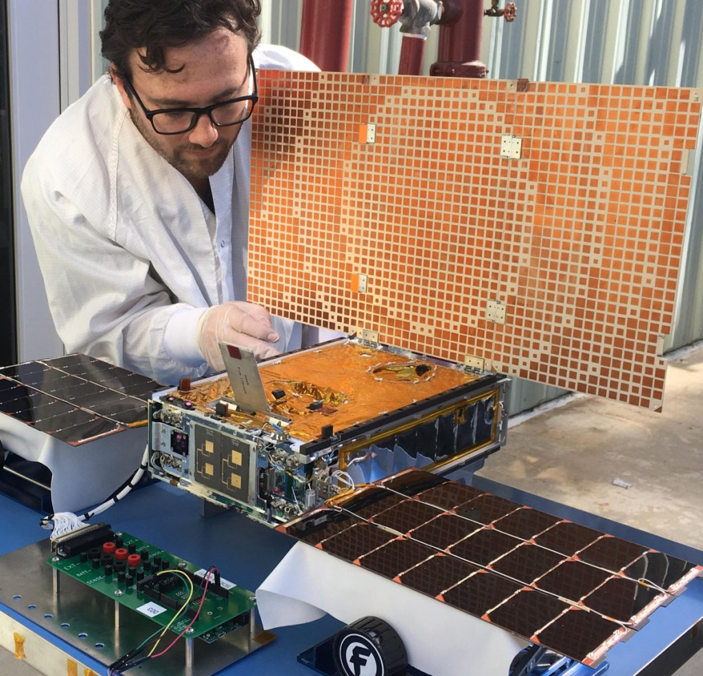 Engineer Joel Steinkraus uses sunlight to test the solar arrays on one of the Mars Cube One project spacecraft at NASA's Jet Propulsion Laboratory in Pasadena, Calif.