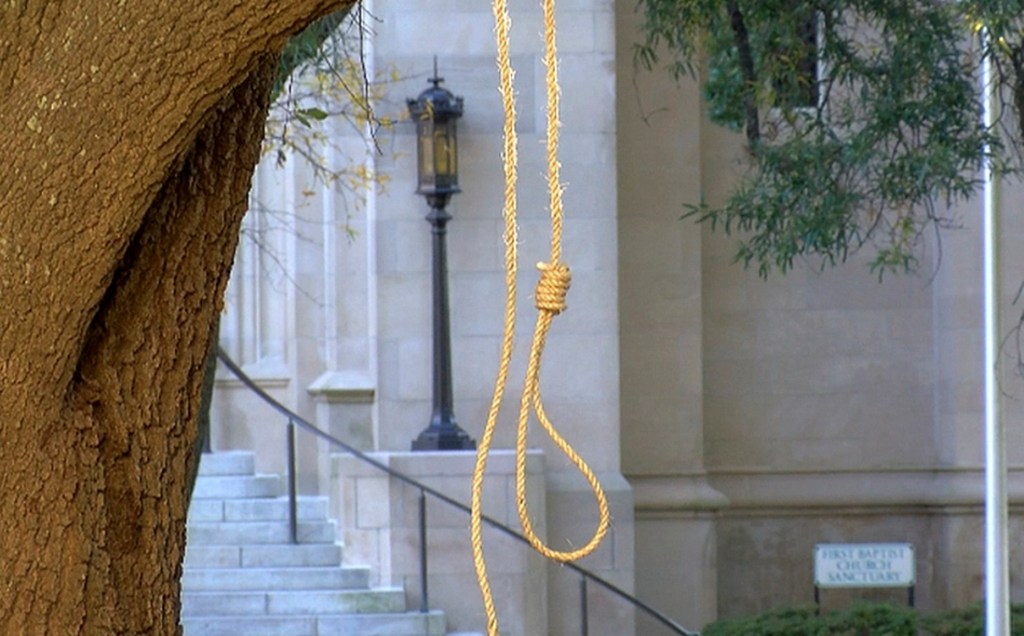 "A noose hangs on a tree on the state capitol grounds in Jackson, Miss., on Monday. One sign that accompanied a noose read ""We're hanging nooses to remind people that times haven't changed."""
