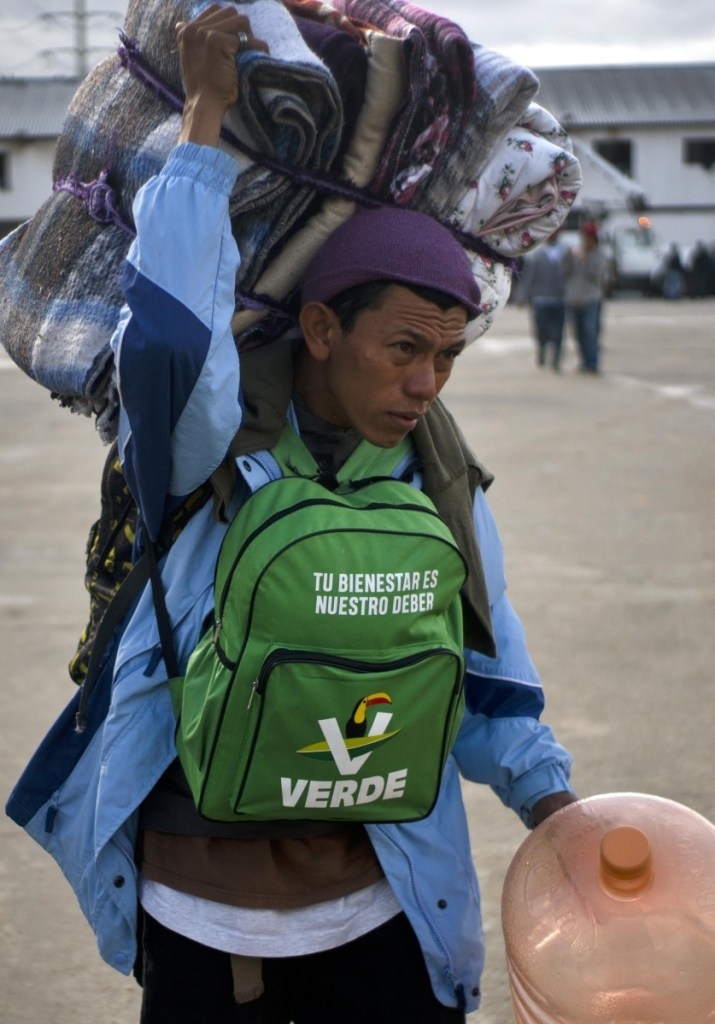 A Hondurant migrant arrives at an events center-turned-shelter in Tijuana on Friday.