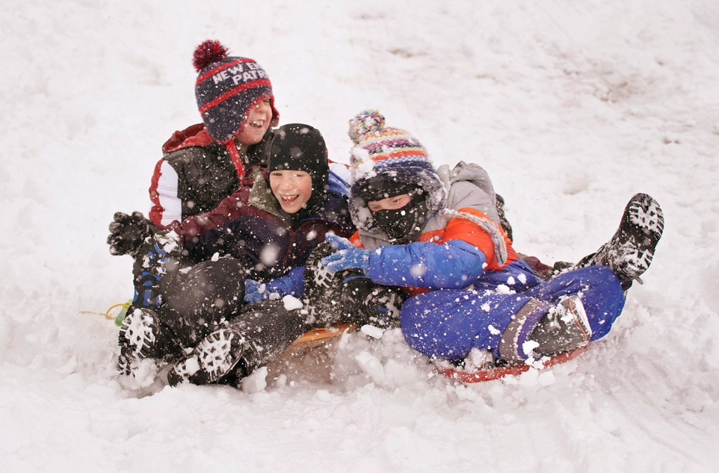 Taking advantage of a snow day from school, Cameron Douglas, 9, Cash Baker, 7 and Grady Foreman, 8, sled down a hill behind Scarborough High School on Nov. 20.