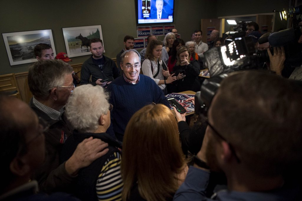 Rep. Bruce Poliquin greets supporters and speaks with the press at Dysart's Travel Stop in Bangor on Tuesday, at what they hoped would be a re-election party.