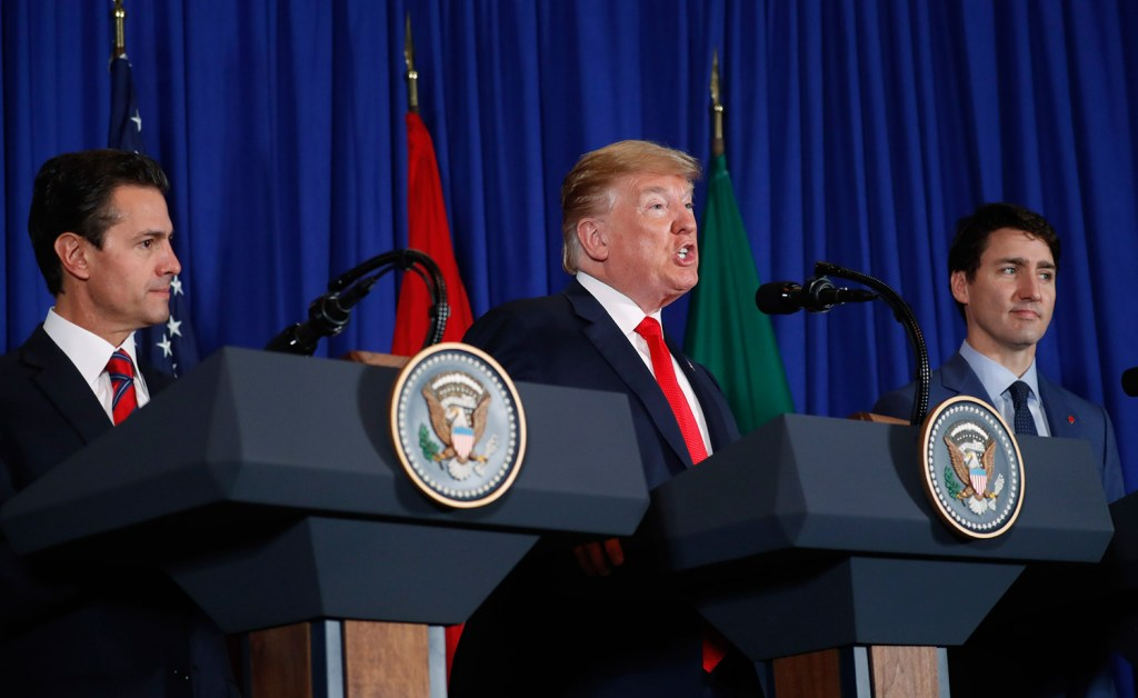 President Trump speaks during the signing ceremony for a new three-nation trade pact with Canada's Prime Minister Justin Trudeau, right, and Mexico's President Enrique Pena Neto, left, on Friday in Buenos Aires, Argentina.