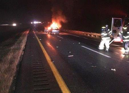Police say Anthony Hodge was distracted by his cellphone when his car slammed into the rear of a 2003 Dodge Dakota on Interstate 95 in Hampden on Thursday night. Hodge's car caught fire.