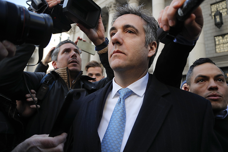 "Michael Cohen walks out of federal court, Thursday, Nov. 29, 2018, in New York. Cohen, President Donald Trump's former lawyer,  pleaded guilty to lying to Congress about work he did on an aborted project to build a Trump Tower in Russia. He told the judge he lied about the timing of the negotiations and other details to be consistent with Trump's ""political message."""