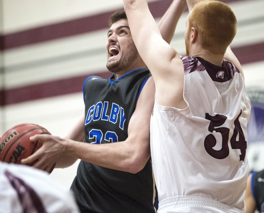 Sean Gilmore, who scored 12 of his 16 points in the second half Tuesday night, drives against Anthony Owens of UMaine-Farmington during Colby's 92-76 victory,