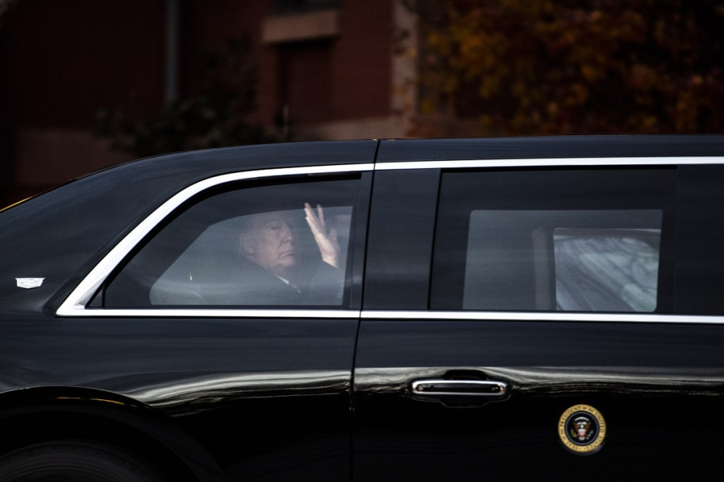 President Trump leaves in the presidential parade limousine after meeting at the Blair House with former President George W. Bush and his wife, Laura.