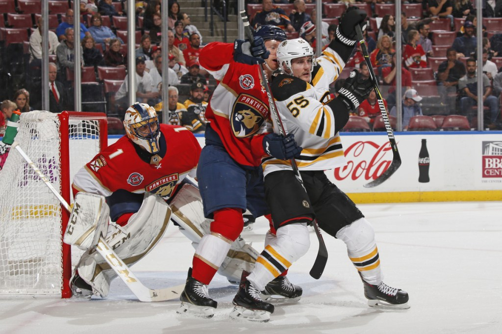 Panthers goalie Roberto Luongo looks for a clear view as defenseman Michael Matheson battles for position with Bruins center Noel Acciari during the second period of Florida's 5-1 win Tuesday in Sunrise, Fla.