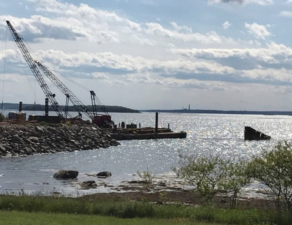 Workers from Reed & Reed remove the old pier at Mitchell Field in Harpswell last June. The 119-acre former fuel depot has been used primarily as recreational land.
