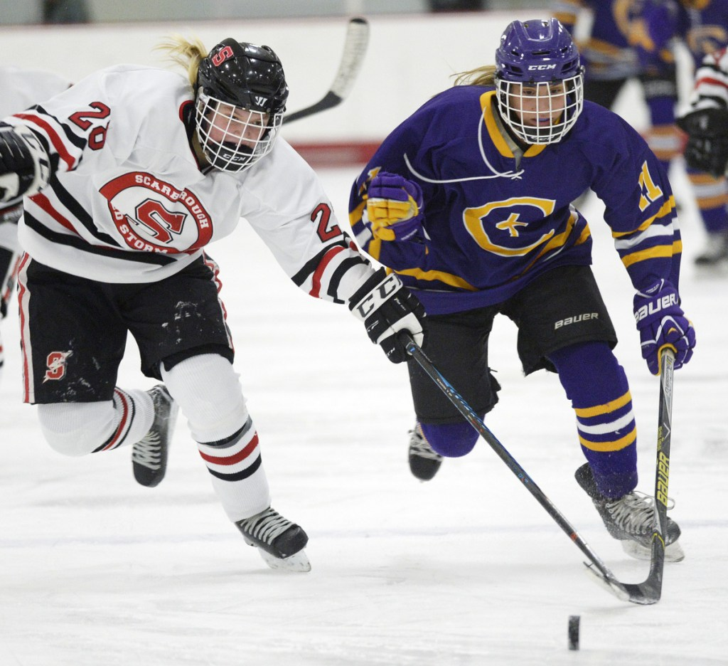 Scarborough's Maya Sellinger, left, and Sophia Pomeo of Cheverus/Kennebunk chase a loose puck Wednesday at USM Ice Arena. Cheverus recorded its fourth shutout in eight games this season.