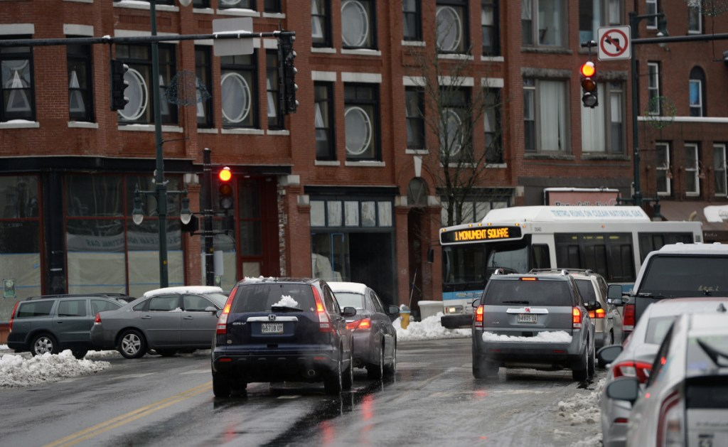 Traffic is stopped at the light at Congress and High streets in Portland. Better timing of traffic signals saves time, money and makes intersections safer.