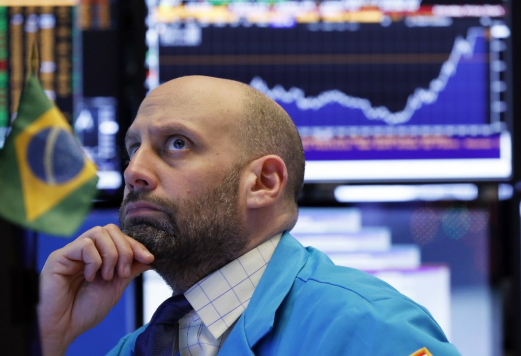 Specialist Meric Greenbaum works the floor Friday at the New York Stock Exchange.