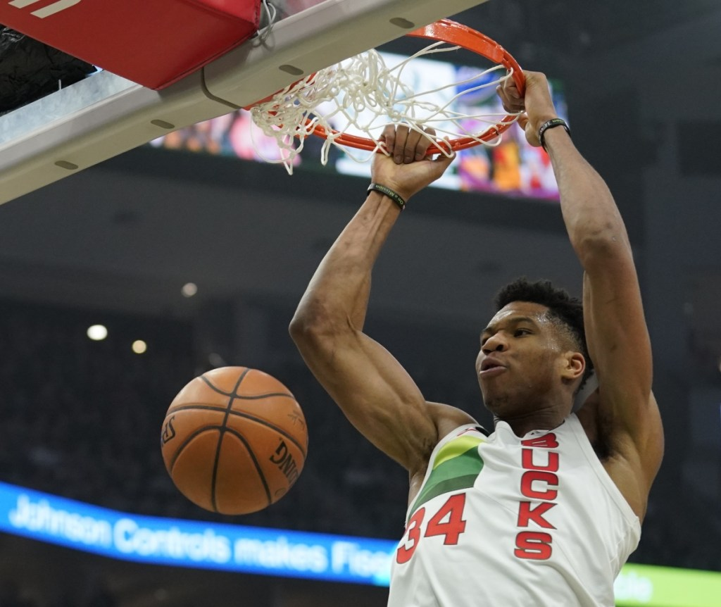 Milwaukee's Giannis Antetokounmpo throws down a dunk in the first half of the Bucks' 129-115 win over the Brooklyn Nets on Saturday in Milwaukee. Antetokounmpo had 30 points, 10 rebounds and 10 assists.