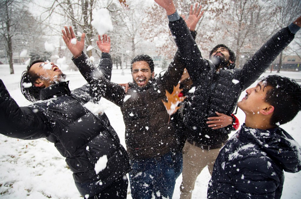PORTLAND, ME - University of Southern Maine students from Nepal, in their first-ever encounter with snow, throw it all over each other in Portland's Deering Oaks park. From left are Spadan Khariwoda, Anamol Dhakal, Resham Pandey and Bikash Sharmi. (Photo by Carl D. Walsh/Staff Photographer)