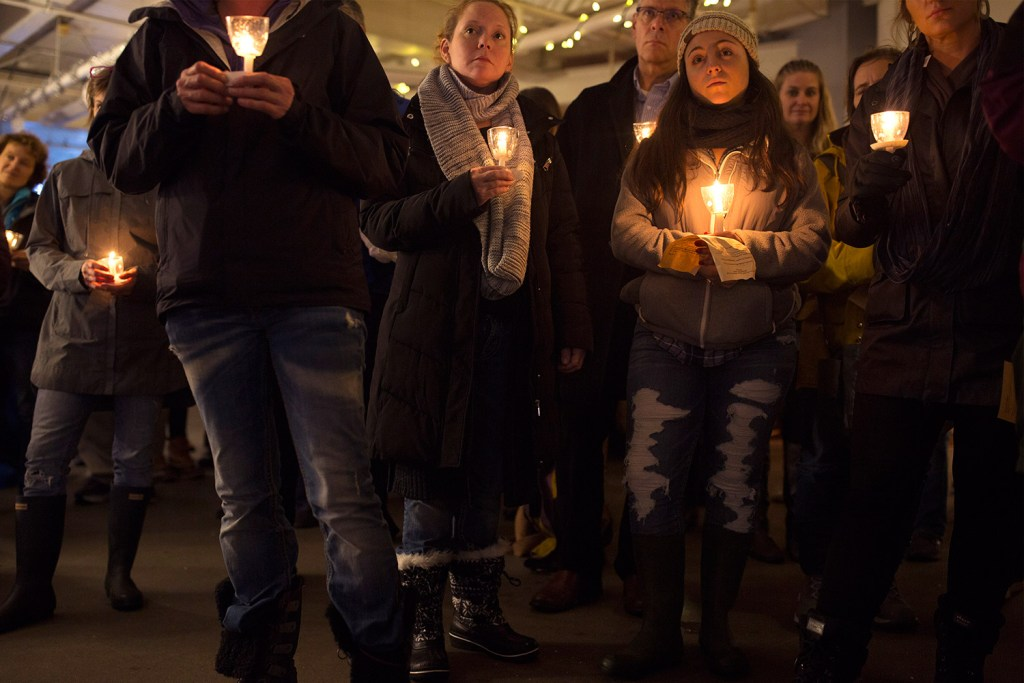 People gather Friday evening at Preble Street for a vigil honoring the 36 people in the homeless community who died in 2018. The vigil is held every year on the longest night of the year, the winter solstice.