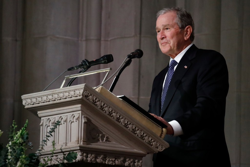 Former President George W. Bush pauses as speaks at the State Funeral for his father, former President George H.W. Bush, at the National Cathedral, Wednesday, Dec. 5, 2018, in Washington.
