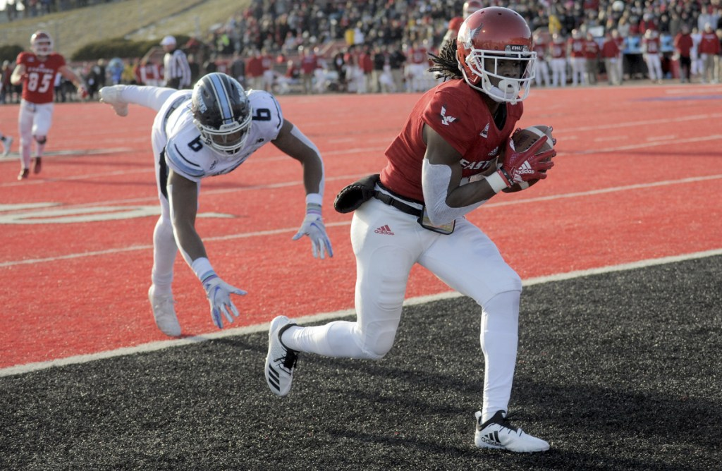 Eastern Washington'S Nsimba Webster (5) scores a touchdown against Maine defender Kayon Whitaker (9) during the first half of a college football game on Saturday, Dec. 15, 2018, in Cheney, Wash. (Kathy Plonka/The Spokesman-Review via AP)