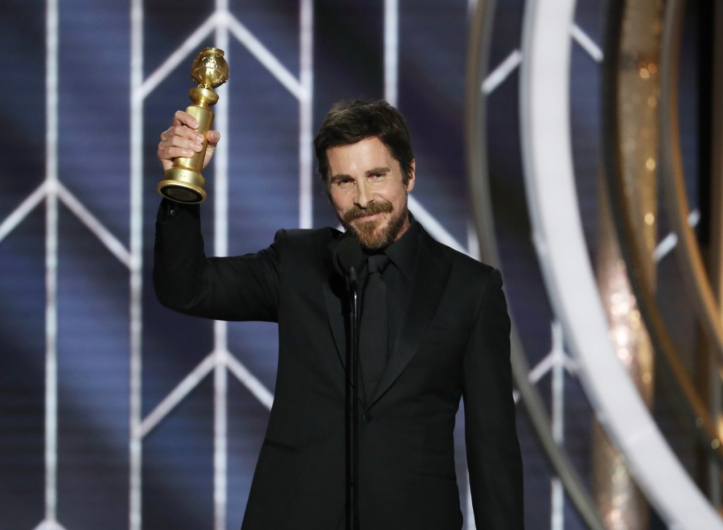 "Christian Bale accepts the Golden Globe for best actor in a motion picture musical or comedy for his role in ""Vice"" at the Beverly Hilton Hotel on Sunday in Beverly Hills, Calif."
