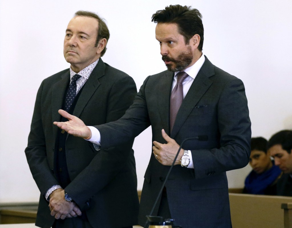 Actor Kevin Spacey stands in district court as his attorney Alan Jackson, right, addresses the judge during arraignment on a charge of indecent assault and battery on Monday in Nantucket, Mass.