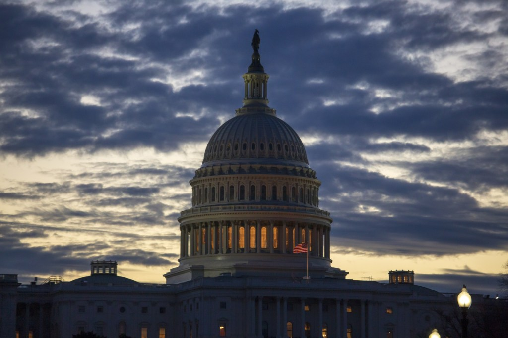 Dawn arrives at the Capitol in Washington, as the partial government shutdown enters day 18 on Tuesday.