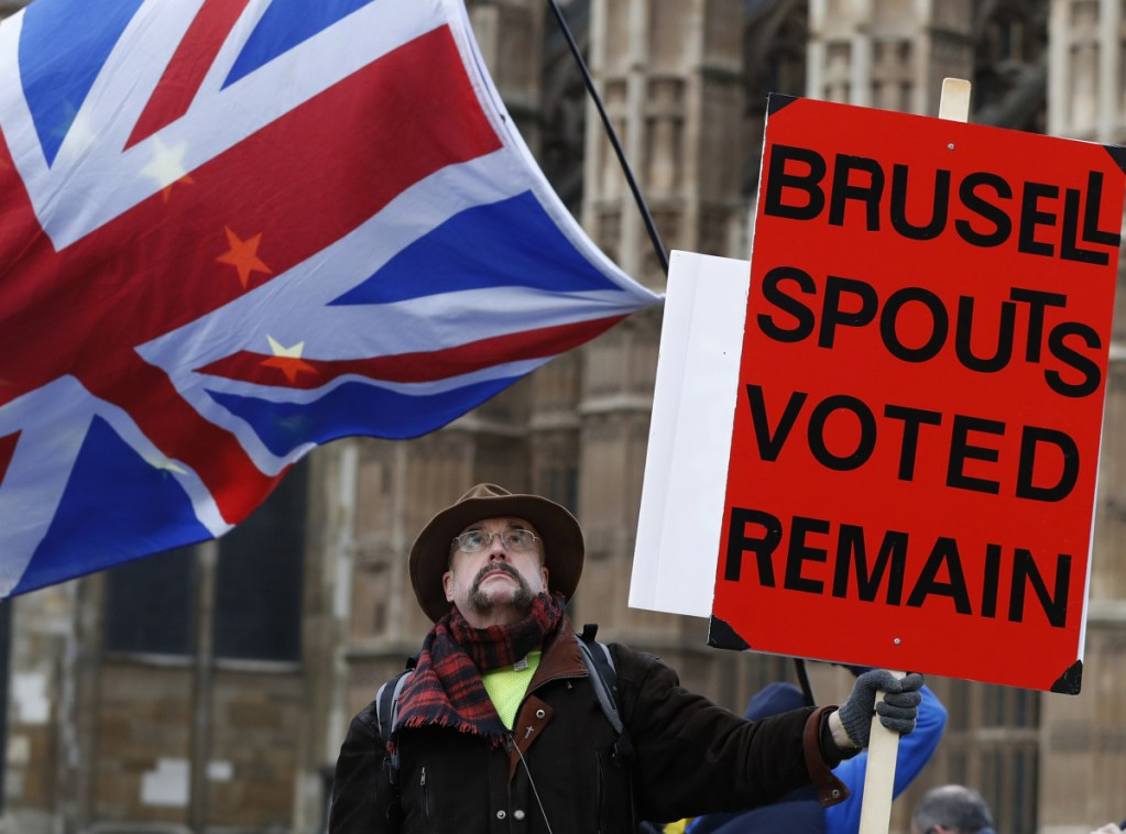 A demonstrator protests in London Wednesday as Parliament debates a Brexit deal that had lacked the votes needed for passage a month ago.